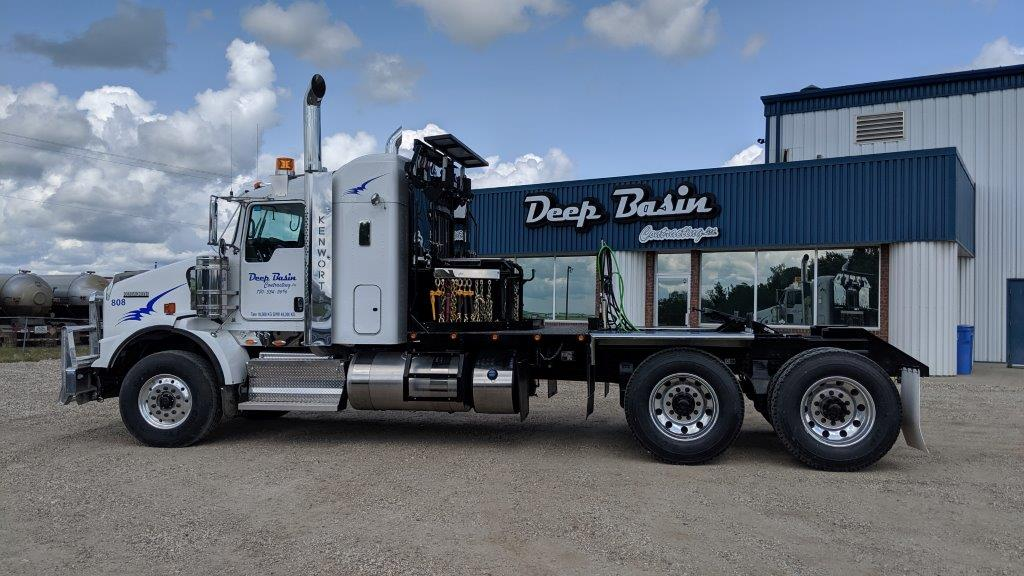 deep basin construction building front with truck